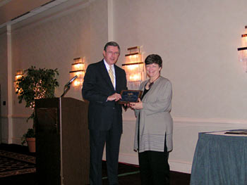 Ron Cowell presents the EPLC Leadership Program Alumni Award to Jean Dexheimer (EPFP class of 2001-02).
