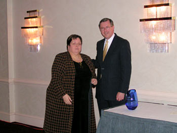 Ron Cowell presents the Edward Donley Education Policy Leadership Award to Dr. Paula Hess.