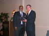 Ron Cowell presents the EPLC Leadership Program Alumni Award to Sylvester Pace (ICLE Pittsburgh class of 2000-01).