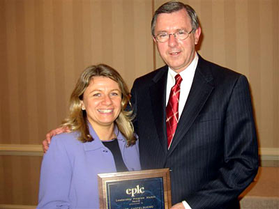 Diane Castelbuono accepts the EPLC Leadership Program Alumni Award from EPLC President Ron Cowell.