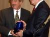 EPLC President Ron Cowell presents the Edward Donley Education Policy Leadership Award to Karl Girton.