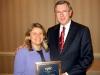 Diane Castelbuono accepts the EPLC Leadership Program Alumni Award from EPLC President Ron Cowell.