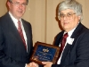 Dr. William Adams accepts the EPLC Leadership Program Alumni Award from EPLC President Ron Cowell.